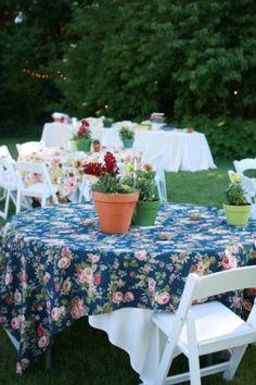 love the idea of mismatched vintage floral tablecloths