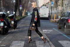 Lisa Hahnbueck wearing off white printed western denim shirt, intimissimi netshirt, set fashion dakota cropped flared leatherpants, christian louboutin andaloulou 100 ankle boots, louis vuitton, louis vuitton supple rigid bag in monogram canvas, prada sunglasses during Milan Fashion Week Fall/Winter 2017/18 on February 24, 2017 in Milan, Italy.