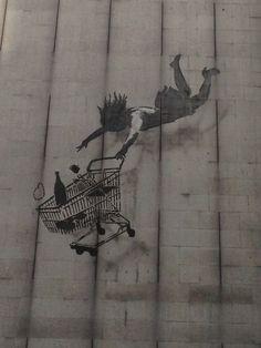The falling shopper - Banksy