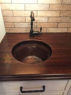 The Round Copper Bar Sink with Grape design is the perfect sink for any wet bar or prep area. The look is complete with the Oil Rubbed Bronze Single Handle Bar Faucet. (Model numbers of items shown: Faucet: Sink: Wet Bar Sink, Kitchen Wet Bar, Copper Kitchen, Kitchen 2016, Basement Bar Designs, Basement Bars, Basement Ideas, Bar Faucets, Bar Sink Faucet