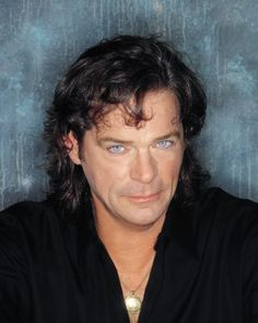 BJ Thomas .. In the 80's, sat across from him in the Atlanta airport.  It was amazing, the double take when people realized it was him.  Oh, those eyes!!!!