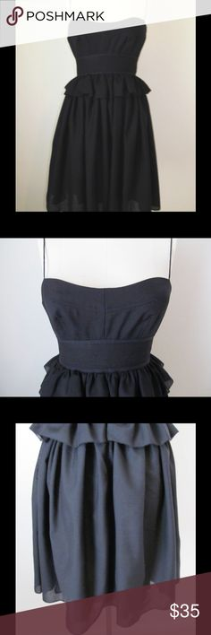 """J Crew Little Black Dress Size 2 Adorable J Crew dress.  Size 2.  Spaghetti straps with back zipper.  Lovely waist detail.   50% wool, 50% polyester.  Fully lined. It has a ruffled peplum around the waist and a full skirt.   Measures:  31"""" chest, 26"""" waist, 36"""" hip, 29"""" length ( top of bust to hem) J. Crew Dresses Mini"""