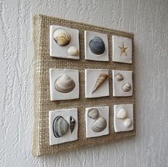 Wall hanging decoration - Coastal decor - Beach style decoration - Shells art - Seashells collage - Clay sculpture - Sea stars decor This wall decoration is made on canvas using sackcloth, clay and seashells. The size is 20 x 20 cm.
