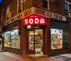 EDDIE'S SWEET SHOP has been in business for over 100 years. Previously called Witts Ice Cream Parlor, this Forest Hills classic was sold to the Citrano family in When we photographed this with its vintage Coca-Cola for our book Coca Cola, Storefront Signage, Restaurant Signage, Shop Signage, Plante Carnivore, Soda, New York Night, Shop Fronts, City Aesthetic