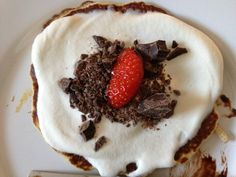 Pancake inspiration: banana pancake dough topped with whipped cream, dark chocolate sprinkle and a strawberry