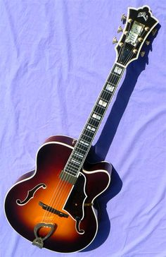 Lovely archtop at only 4995. 1994 Guild Artist Award,  http://www.archtop.com/ac_94AA_512.html#