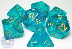 """Wow, these are some good looking dice. Sparkling, richly-colored teal dice with gold numbers manufactured by Chessex as part of their """"""""Borealis"""""""" line, these puppies will really grab attention at the"""