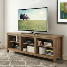 "Features:  -High-grade MDF and laminate construction.  -Adjustable shelving and ample storage space.  -Finish: Barnwood.  TV Size Accommodated: -70"".  Product Type: -TV Stand.  Design: -Open shelving."
