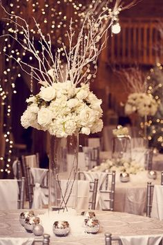 """the TABLESCAPE {Creating the first layer of the table design,  the table was set with a circle-patterned contemporary, yet elegant sheer overlay on a silver satin table cloth. The table was given a heavy dose of """"fallen snow"""", along with the custom designed floral arrangements and mirrored glass votives. The silver Chiavari chairs were gently draped with a simple, white satin tie pinned with a square diamond brooch. Bring on the bling!} Floral + Event Styling by Junkerman Jones, Wedding…"""