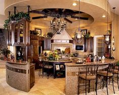 I would absolutely die to have this kitchen!! Love how the round kitchen really opens it up to the rest of the house. Great for entertaining!
