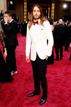 Best Supporting Actor winner Jared Leto in a Saint Laurent suit; Paiget vintage ruby shirt studs and premier cufflinks in 18K yellow gold at the 86th Annual Academy Awards. #JaredLeto #Oscars #RedCarpet