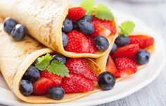 Yogurt berry wraps -- Mix ½ cup of plain, nonfat Greek yogurt with ½ teaspoon cinnamon, 1¼ teaspoon ground ginger and 2 teaspoons honey. Spread a whole-wheat tortilla with two heaping spoonfuls of the spiced yogurt. Put two handfuls of mixed berries (sliced strawberries, raspberries, blackberries and blueberries) half and inch from the right border, and sprinkle chopped almonds or hazelnuts on top for added crunch and flavor
