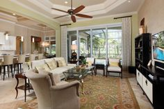 Decorator fans and lighting, multi-tier tray ceilings and crown moulding.