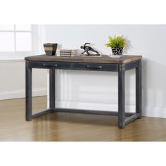 @Overstock - Heritage Writing Desk - This heritage writing desk has a weathered finish and is made of durable rubberwood. This rustic desk will add character to any room in your home.   http://www.overstock.com/Home-Garden/Heritage-Writing-Desk/7986760/product.html?CID=214117 $419.99