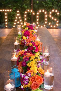 How To Decorate Wedding Taco Bar ❤ wedding taco bar on a long table bright flowers and candles on the background inscription tacos with light bulbs bohemiadelmar ❤ See more: http://www.weddingforward.com/wedding-taco-bar/ #weddingforward #wedding #bride #decor #weddingdecorations #bridaldecorations #weddingtacobar