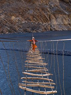 plank suspension bridge across the Hunza River, northern Pakistan