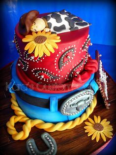 LOVE the details on this cowboy cake !!!  I would prob put a different top on it though.