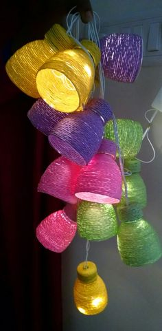 Recycled plastic bottles into a string of lights. Recycled plastic bottles into a string of lights.How to make decorative hangings from thread-wrapped plastic bottles - Simple Craft Plastic Bottle Craft Ideas For Many Uses - 21 and MarriedYou Empty Plastic Bottles, Plastic Bottle Flowers, Plastic Bottle Crafts, Recycled Bottles, Plastic Craft, Plastic Bottle Decoration, Plastic Waste, Upcycled Crafts, Recycled Decor