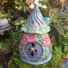 The largest of the floral #fairyhouses in this collection. Covered in giant pink magenta blossoms, butterflies and bees. Shop Update tonight 12/04 at 7:00 PM EST  link in profile #fairy #fae #faehome #forthefairies #fairyhouse #pottery #handmadelove #handcrafted