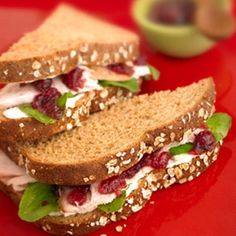 Cranberry Turkey and Arugula Sandwiches-  Like chicken, the lean protein appears to help keep your immune system strong while giving you more energy. Here, cranberries may help fight inflammation.Peppery arugula and cranberry-raspberry crushed fruit makes these turkey sandwiches special enough to serve to guests...but they're so good, you'll want to serve them all the time. #totalbodytransformation
