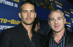 aul Walker (left) and producer David Zelon attends the premiere of Sony Pictures 'Into the Blue' at the Mann Village Theatre on September 21, 2005 in Westwood, California.