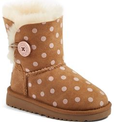 This favorite short boot fashioned from super-cozy shearling is updated with charming polka dots and a buttoned shaft for a cute cuffed look.