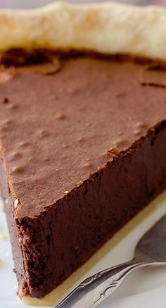 Homemade Chocolate Fudge Pie with Rich and Dense, Moist Chocolate Filling.