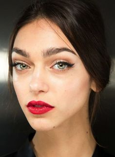 The lips! The eyes! The hair! One thing's for sure— Dolce & Gabbana is the master of romantic style, and the beauty look at the F/W 2015 show is no exception. With a stunning mix of red and mauve lips, cat-eye liner and embellished hair pieces, we're definitely keeping these looks in mind for wedding beauty inspiration!  Keep scrolling to see the beauty inspiration and our makeup picks for getting the look... via @WhoWhatWear
