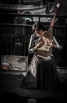 Pipa琵琶 : It is a plucked Chinese string instrument. Sometimes called the Chinese lute, the instrument has a pear-shaped wooden body. It has been played for nearly two thousand years in China, and belongs to the plucked category of instrument.