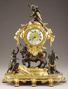 ,A FRENCH NAPOLEON III GILT AND PATINATED BRONZE MANTEL CLOCK. Circa 1852-1870.