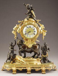 ,A FRENCH NAPOLEON III GILT AND PATINATED BRONZE MANTEL CLOCK. Circa 1852-1870.
