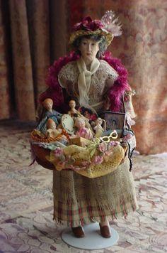 vendedora de muñecas/doll peddler