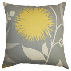"Bring a pop of color to a neutral sofa or loveseat with this eye-catching pillow, showcasing a floral motif.  Product: PillowConstruction Material: Cotton cover and down fillColor: DoveFeatures:  Insert includedHidden zipper closureMade in the USA Dimensions: 18"" x 18"""