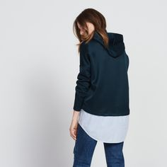 Sandro sweater with hood<br /> • Round neck and long sleeves<br /> • Drawstring at the hood<br /> • Slightly batwing sleeves<br /> • Striped shirt built into the hem of the sweater<br /> • Model is wearing a size 1<br /><br />