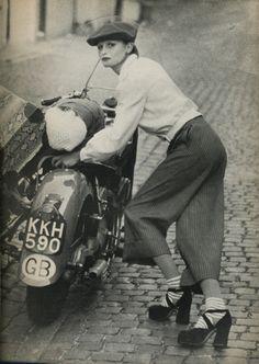 Vogue UK, 1972 | fashion | editorial | posing | motorbike | mod | cobble stone | tweed/Gaucho pants & Platform shoes