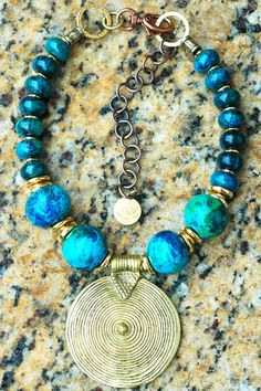 XO Gallery Jewelry-Aegean Blue, Grecian terra cotta beads, Chrysocolla, Carved antique gold tubes and Tibetan Brass shield pendant
