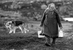 Inga I (blog about the Sami) The photo is deceiving: This is not a wolf, and Inga Kemi is not a poor woman. She lived well in an ordinary house in the Norwegian town of Karasjok until passing away in 1997. Inga was fetching water from the stream for cooking. Her traditional footwear is called Komager. Made of otter hides, they are used during spring because the fur is water-resistant. They are rarely worn by the younger generations.