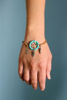Dream Catcher on the go! No bad dreams will haunt you with this on your wrist; therefore, thumbs up!