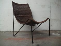 Eames Inspired Wicker and Iron Lounge Chair by neotericinland