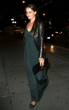 Katie Holmes wearing a envy green maxi dress, Alaia Flats, Hermes Medor Clutch, & a Holmes & Yang leather Jacket.
