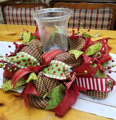 CHRISTMAS IN JULY SALE!!! USE COUPON CODE JULYJINGLE FOR 20% OFF ANY CHRISTMAS WREATH! REGULAR PRICE $44.00. WITH COUPON CODE IS $35.20 THROUGH JULY 31. This is a traditional red and green Christmas centerpiece or small wreath made with a red and lime green paper mesh. Paper mesh is best used indoors, but it is ok to hang on your door if it is covered. Paper mesh can fade in direct sun. My front door gets the evening sun, and paper mesh wreaths have faded on my front door. I used a variety…