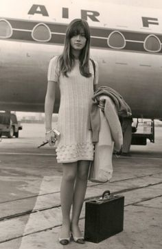 Françoise Hardy arriving in London off an Air France flight.  She was a french pop singer and actress.  She was born in Paris, France in 1944.
