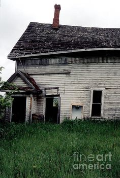 Grama's schoolhouse is being reclaimed by the earth. This was a few years ago. It is not standing this tall now.