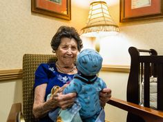 """Doll therapy for dementia. When asked what she likes about the dolls, Vivian Guzofsky (who has Alzheimers) says, """"I love babies."""" Sunrise caregivers also use the dolls to spark conversations by asking questions: How many children do you have? Was your first baby a boy or a girl? What are the best things about being a mom? Many women have an identity based around caregiving and good memories associated with it."""