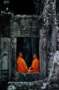 Monks in Bayon Temple, Angkor, Cambodia. I've also been here, it is also Incredible!