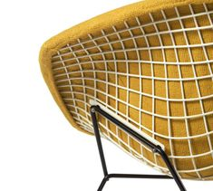 design-is-fine: Harry Bertoia and Antoinette Lackner Webster (upholstery Knoll Textile Prestini) on a Small Diamond chair, ca. Plastic coated wire and rod frame, foam rubber cushion, cotton upholstery. Harry Bertoia, Vintage Furniture Design, Cool Furniture, Modern Furniture, Eames, Le Manoosh, Tumblr Yellow, Textures Patterns, Deco