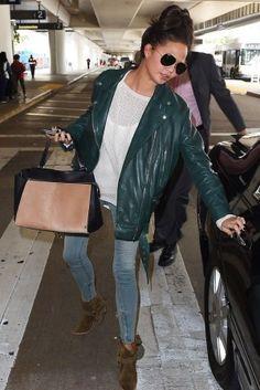 Chrissy Teigen wearing Isabel Marant Rawson Harness Boots, Celine Edge Two Tone Bag in Camel/Black, Rag & Bone Zipper Capri Jeans in Seafoam and Acne Swift Jacket