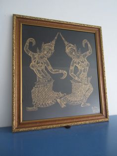 This is a beautiful stone rubbing from and Bangkok temple on Maharaj Street. It was done on black fabric with gold ink or paint. Stone rubbings of temples in Thailand have been outlawed for many years because of the damage to the temples.   This rubbing is of two woman performing the fingernail dance. A traditional dance of northern Thailand for royalty. It involved very intricate movements of woman wearing brass fingernails.