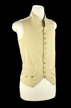 Royal Naval uniform: pattern 1812. Single-breasted waistcoat of white wool twill belonging to a flag officer. The garment is lined with white silk twill and backed with calico. It is interesting to note that it still retains the three-pointed pocket flaps, introduced with the 1748 patterns. 19th Century
