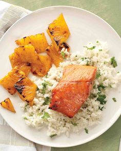 A little cayenne added to maple syrup creates a luscious glaze for broiled salmon and pineapple chunks. Fluff hot rice with cilantro leaves and you're done.